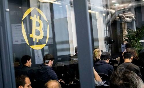 Tâm lý mua vào vẫn chi phối thị trường Bitcoin.Ảnh: Bloomberg