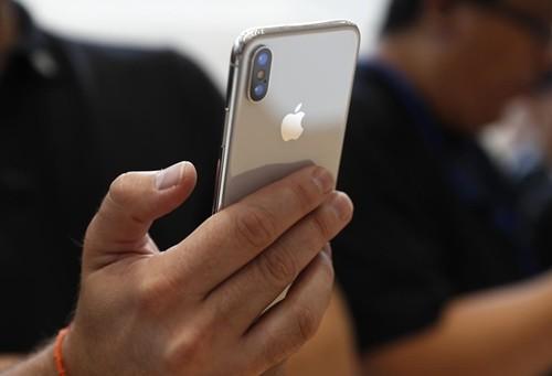 Apple được dự báo chuyển hàng trăm tỷ USD về nước. Ảnh:Reuters