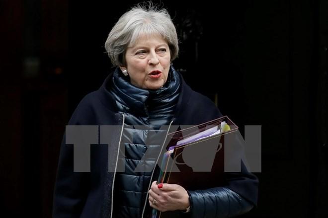 Thủ tướng Anh Theresa May tham dự cuộc họp báo tại London ngày 10/1. (Nguồn: THX/TTXVN)