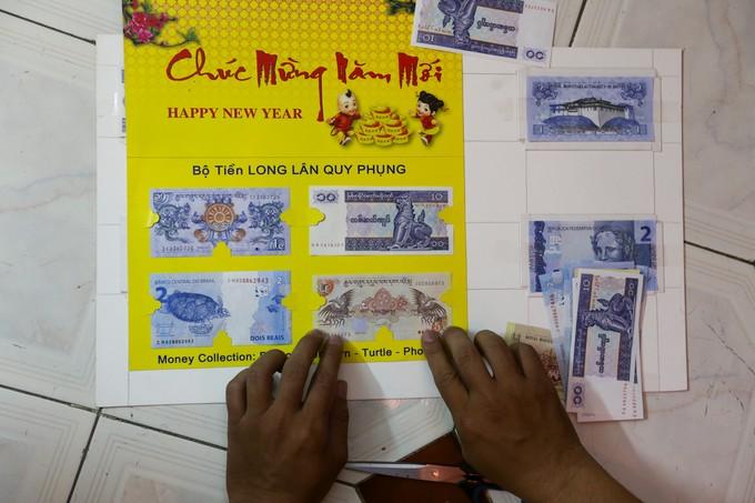 Săn tiền in hình linh vật Tết Mậu Tuất để lì xì ở Sài Gòn - ảnh 10