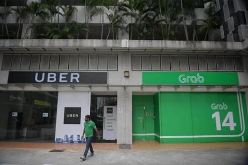 Uber đầu tuần này đã tuyên bố bán mảng Đông Nam Á cho Grab. Ảnh:Straits Times