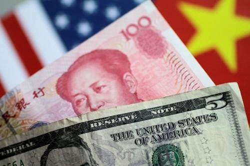 NDT quý trước tăng giá 0,8% so với USD. Ảnh:Reuters