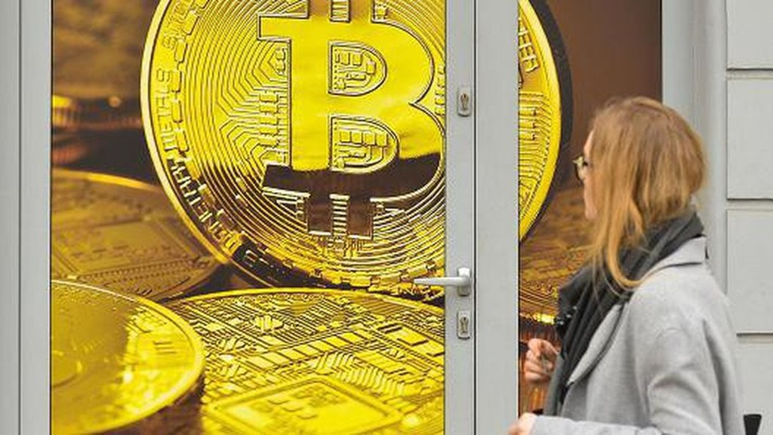 Các nhà giao dịch hiện đang theo dõi xem liệu giá Bitcoin có thể trụ được mốc 7.500 USD - Ảnh: Getty/CNBC.