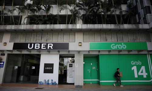 Văn phòng của Uber và Grab tại Singapore. Ảnh:Reuters.