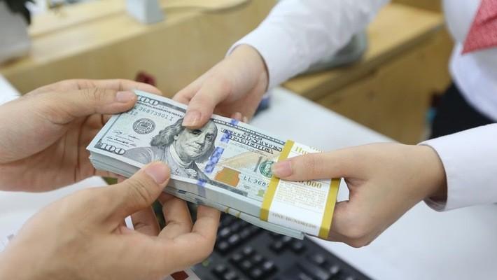 Trong hơn hai năm qua, Ngân hàng Nhà nước đã mua thêm tới 32 tỷ USD - Ảnh: Quang Phúc.