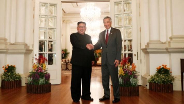 Những hình ảnh đầu tiên của ông Trump và ông Kim Jong Un ở Singapore - ảnh 5