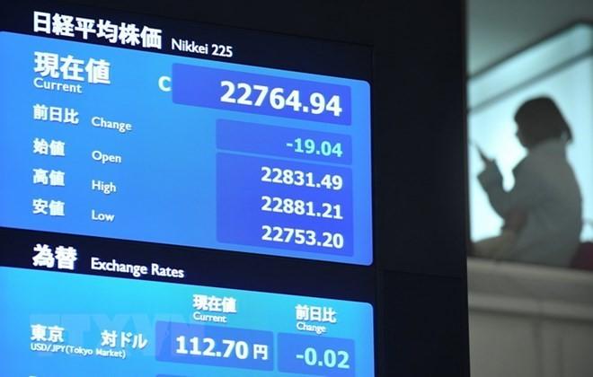 Bảng tỉ giá chứng khoán tại Tokyo, Nhật Bản. (Nguồn: AFP/TTXVN)