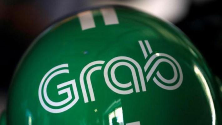 Dịch vụ giao hàng thực phẩm có thể đặt Grab vào thế cạnh tranh trực tiếp với những công ty như Amazon.com, RedMart hay Lazada - Ảnh: Reuters.