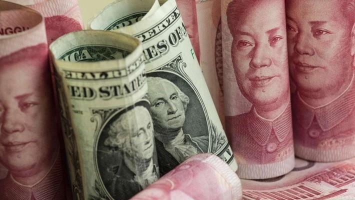 Từ mức đỉnh vào tháng 3 đến nay, Nhân dân tệ đã rớt giá 8% - Ảnh: SCMP.