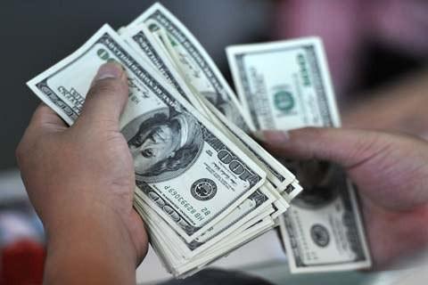 Giá USD ngân hàng và chợ đen lại bật tăng. Ảnh: PV.
