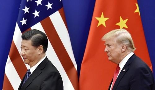 Chủ tịch Trung Quốc - Tập Cận Bình và Tổng thống Mỹ - Donald Trump. Ảnh:Kyodo