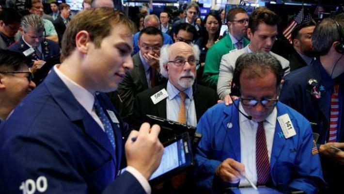 Các nhà giao dịch cổ phiếu trên sàn NYSE ở New York, Mỹ, ngày 12/9 - Ảnh: Reuters.
