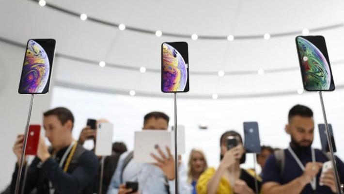 Những mẫu iPhone mới được trưng bày tại lễ ra mắt sản phẩm ngày 12/9 của Apple - Ảnh: Reuters.