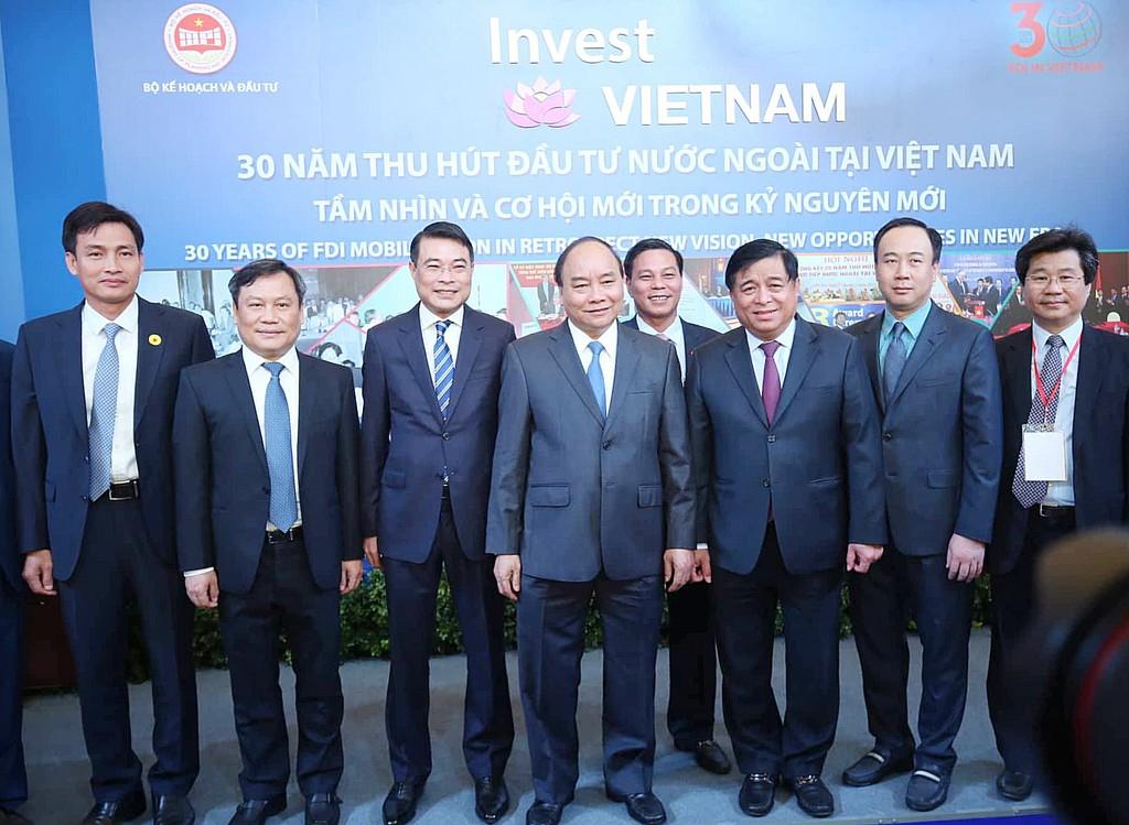 Thủ tướng Nguyễn Xuân Phúc và Bộ trưởng Bộ KH&ĐT Nguyễn Chí Dũng cùng các đại biểu tại hội nghị. Ảnh: Khôi Lâm