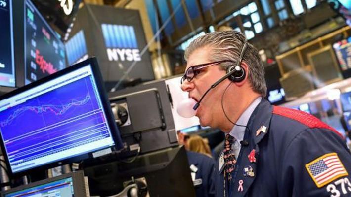 Một nhà giao dịch cổ phiếu trên sàn NYSE ở New York, Mỹ - Ảnh: Getty/CNBC.