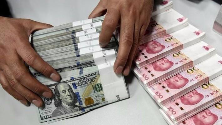 Trong vòng 6 tháng qua, đồng Nhân dân tệ đã giảm giá 9% so với đồng USD, trở thành một trong những đồng tiền rớt giá mạnh nhất ở khu vực châu Á - Ảnh: Reuters.