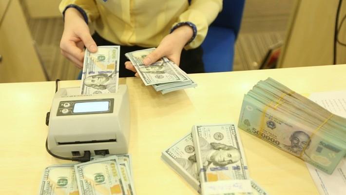 Tỷ giá USD/VND liên tiếp có những bước giảm trong một tuần đồng USD và Nhân dân tệ có biến động rất mạnh - Ảnh: Quang Phúc.