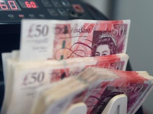 Giá đồng bảng Anh hôm nay 12/11 giảm mạnh. Ảnh: TTXVN