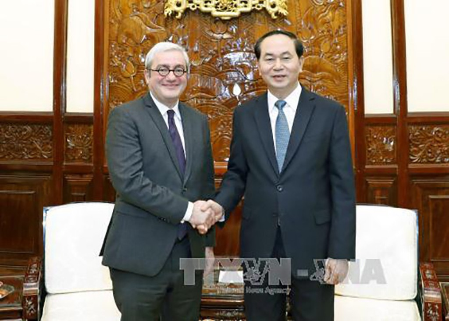 Chủ tịch nước Trần Đại Quang tiếp Chủ tịch, Giám đốc điều hành Hãng thông tấn Pháp (AFP) Emmanuel Hoog đang có chuyến thăm và làm việc tại Việt Nam. Ảnh: TTXVN