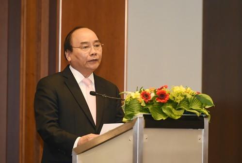 Thủ tướng phát biểu tại Diễn đàn Doanh nghiệp Việt-Đức. Ảnh: VGP