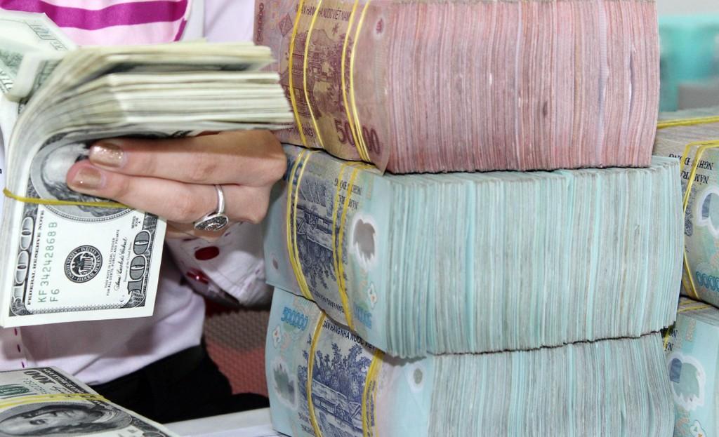 Tính đến ngày 20/06/2017, tỷ giá NHTM xoay quanh mức 22.726 đồng/USD. Ảnh: Tường Lâm