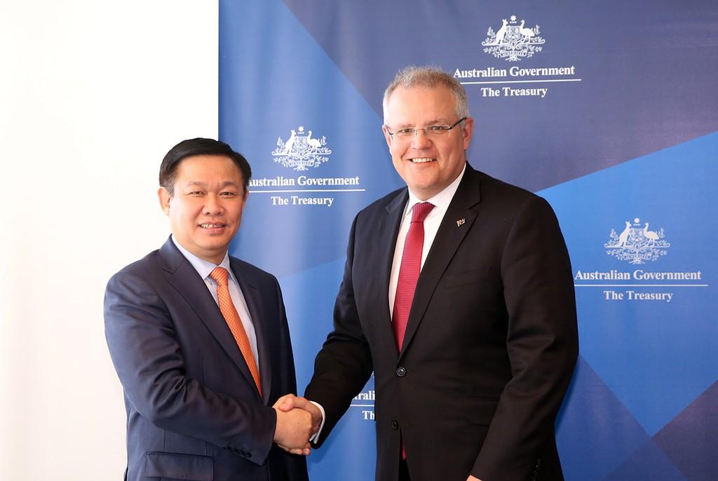 Phó Thủ tướng Vương Đình Huệ và Bộ trưởng Ngân khố Scott Morrison. Ảnh: VGP