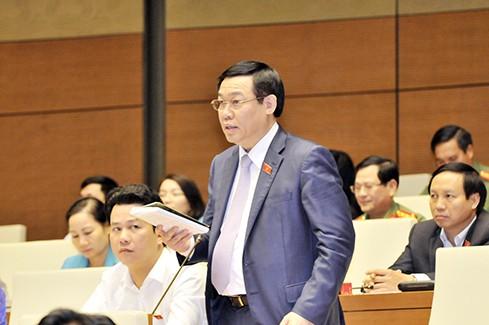 TOÀN CẢNH: Bộ trưởng Bộ Tài chính Đinh Tiến Dũng trả lời chất vấn - ảnh 1