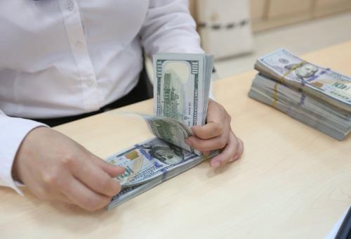 Tỷ giá USD hôm nay 5/12 biến động nhẹ. Ảnh minh họa: TTXVN
