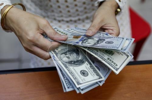 Tỷ giá USD hôm nay 13/12 ổn định. Ảnh: EPA