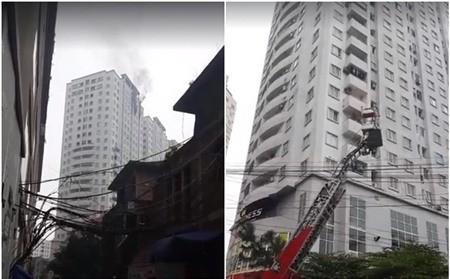 Khói bốc cao từ cửa sổ căn hộ bị cháy, lực lượng PCCC dùng xe thang tiếp cận hiện trường - Ảnh: FB