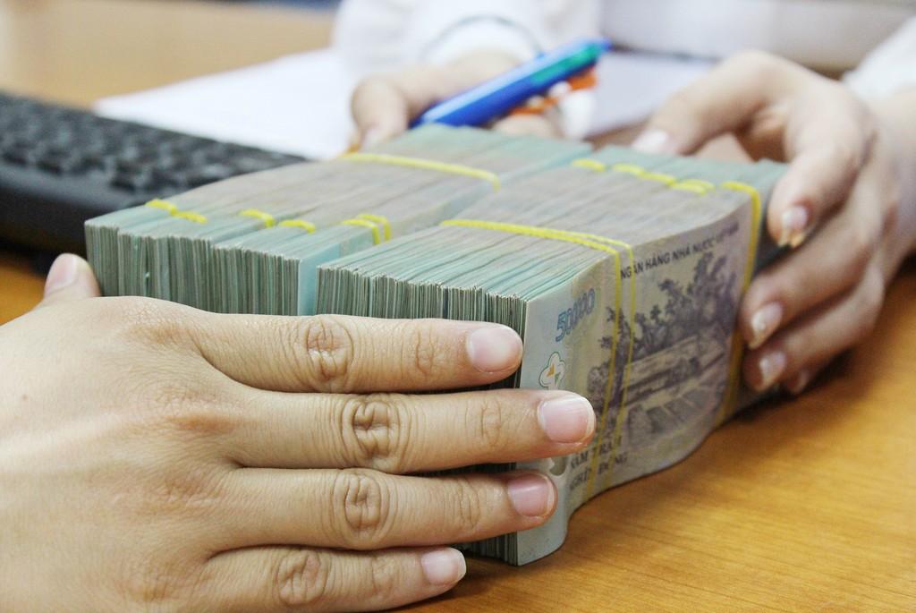 Thủ tướng phê duyệt kế hoạch trả nợ của Chính phủ năm 2018 là 256.769 tỷ đồng. Ảnh: Tường Lâm