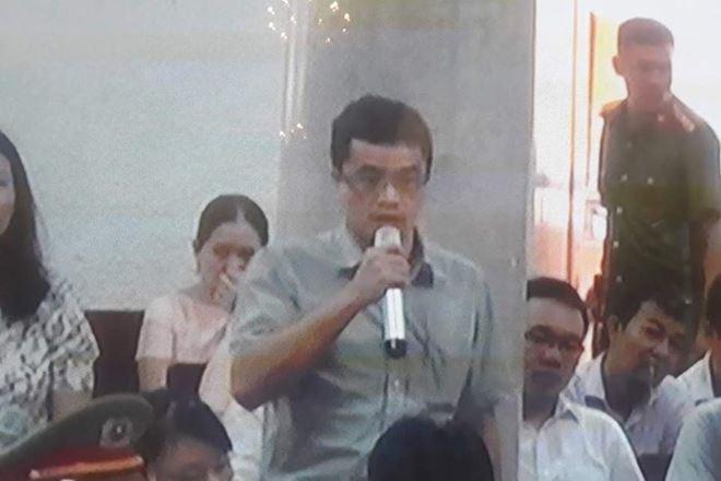 Ông Quang tại phiên tòa sơ thẩm.