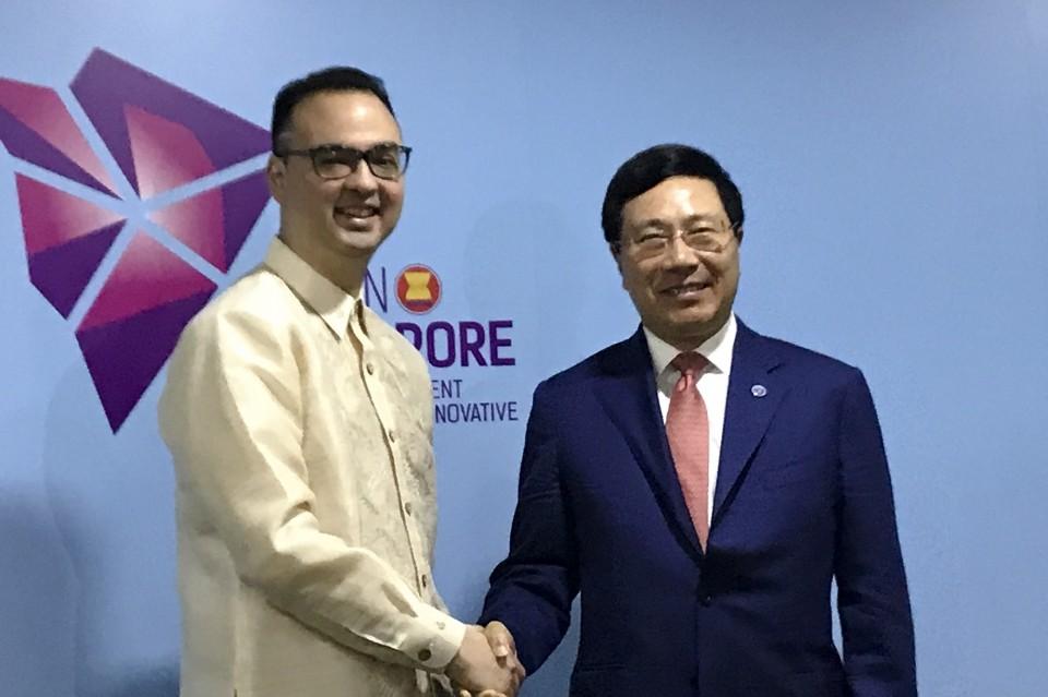 Phó Thủ tướng Phạm Bình Minh và Bộ trưởng Ngoại giao Philippines Cayetano. Ảnh: Báo Thế giới &Việt Nam