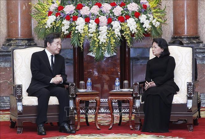 Quyền Chủ tịch nước Đặng Thị Ngọc Thịnh và Thủ tướng Hàn Quốc Lee Nak-yeon. Ảnh TTXVN