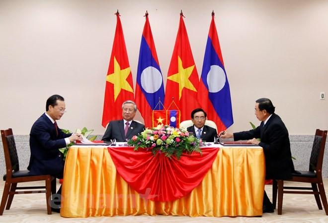 Tổng Bí thư, Chủ tịch Lào tiếp Thường trực Ban Bí thư Trần Quốc Vượng - ảnh 1