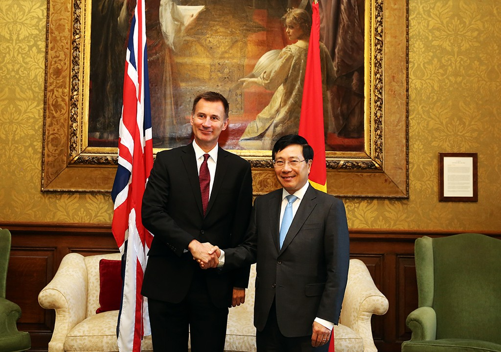 Phó Thủ tướng, Bộ trưởng Ngoại giao Phạm Bình Minh hội đàm với Bộ trưởng Ngoại giao Anh Jerremy Hunt. Ảnh: VGP