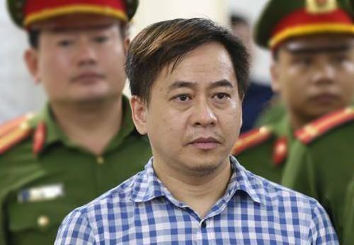 Bị cáo Phan Văn Anh Vũ trong phiên tòa sơ thẩm. Ảnh: TTXVN
