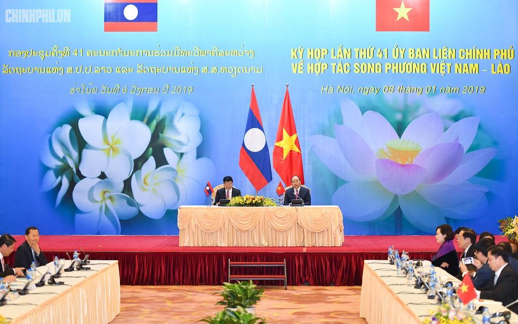 Hai Thủ tướng đồng chủ trì Kỳ họp 41 Ủy ban Liên Chính phủ Việt Nam - Lào - ảnh 12