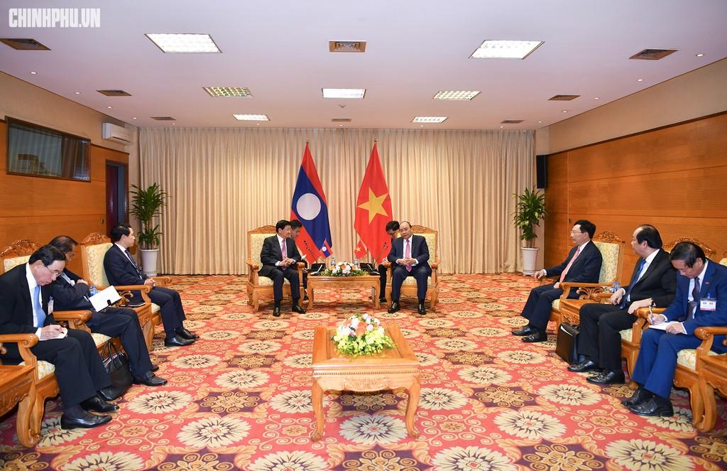 Hai Thủ tướng đồng chủ trì Kỳ họp 41 Ủy ban Liên Chính phủ Việt Nam - Lào - ảnh 1