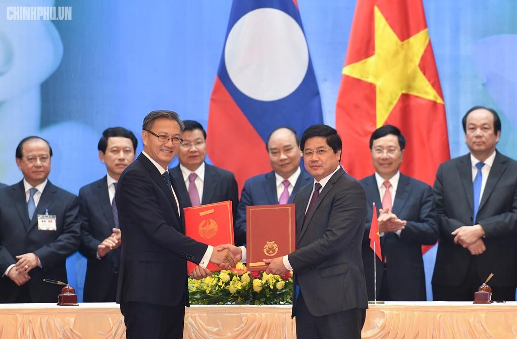 Hai Thủ tướng đồng chủ trì Kỳ họp 41 Ủy ban Liên Chính phủ Việt Nam - Lào - ảnh 7