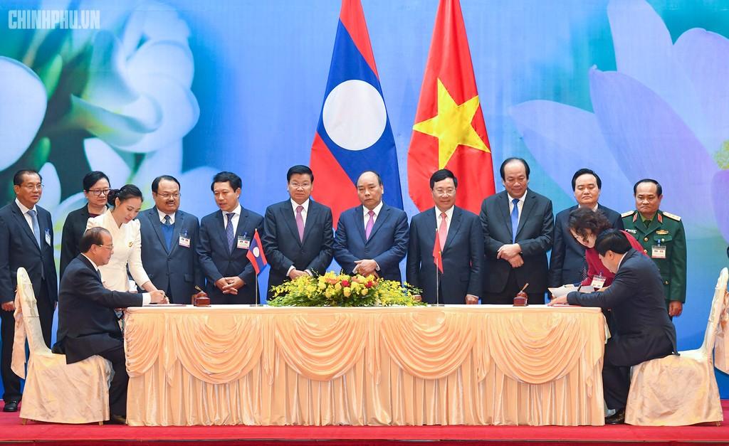 Hai Thủ tướng đồng chủ trì Kỳ họp 41 Ủy ban Liên Chính phủ Việt Nam - Lào - ảnh 8