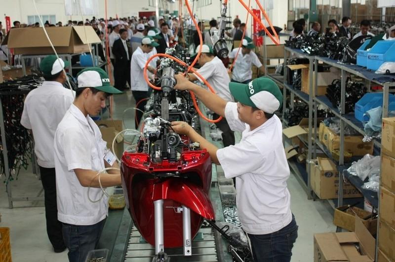 Sản xuất xe máy tại Công ty Kymco- Bình Dương. Ảnh: T.H