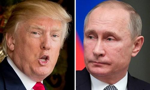 Tổng thống Mỹ Donald Trump (trái) và người đồng cấp Nga Vladimir Putin. Ảnh:AP.