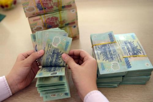 Ngân hàng Nhà nước cho biết giảm lãi suất là để hỗ trợ doanh nghiệp. Ảnh: PV.