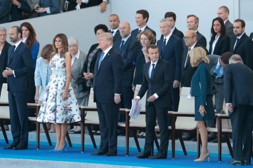 Tổng thống Trump và Đệ nhất phu nhân Melania ngồi ở hàng ghế khách mời danh dự. (Ảnh: AFP)