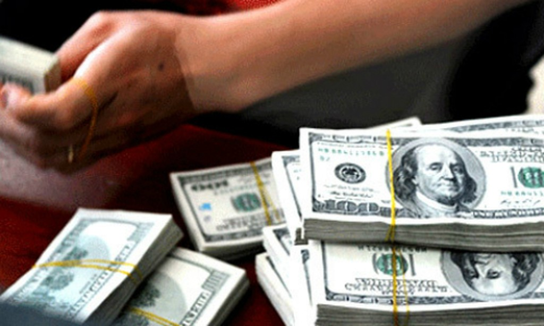Lãi suất huy động USD được duy trì mức 0% một năm gần 2 năm nay.Ảnh: Anh Quân
