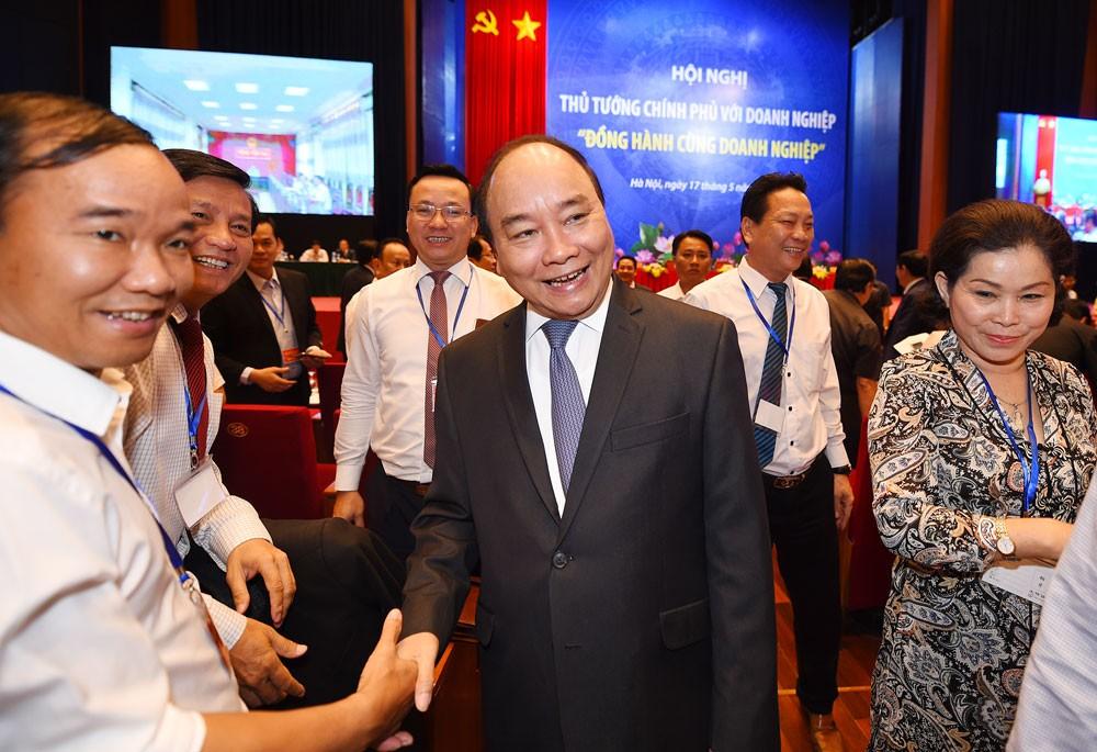 Chính phủ đã tổ chức hàng chục hội nghị xúc tiến đầu tư, hàng trăm cuộc đối thoại với doanh nghiệp. Ảnh: Quang Hiếu