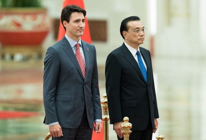 Thủ tướng Canada Justin Trudeau (trái) và Thủ tướng Trung Quốc Lý Khắc Cường. (Nguồn: Getty Images)