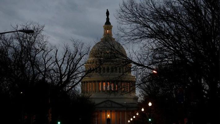 Tòa nhà Quốc hội Mỹ trên Đồi Capitol ở Washington DC tối ngày 21/1 - Ảnh: Reuters.