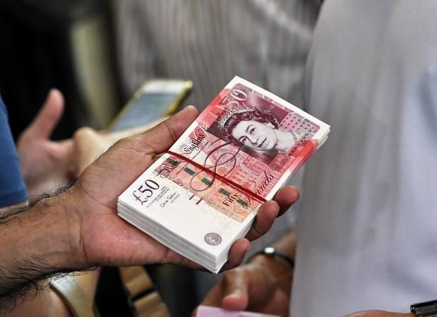 Tiền bảng Anh. (Ảnh: AFP/TTXVN)